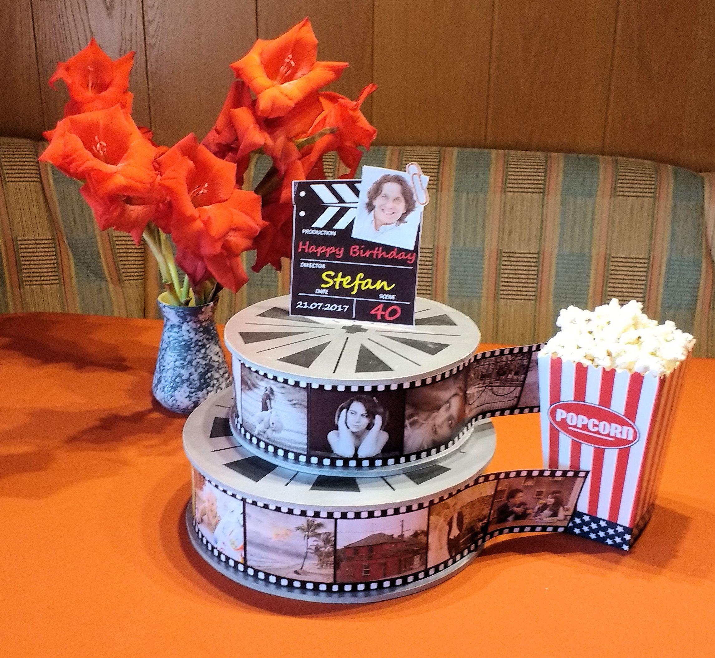 Ein Hingucker für jeden Geburtstag: Filmrollen, Regieklappe und eine Tüte frische Popcorn
